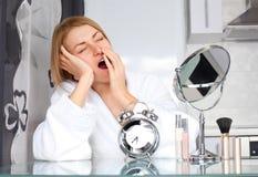 Woman applying makeup Royalty Free Stock Photography