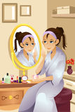 Woman applying makeup royalty free illustration