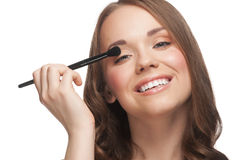 Woman applying makeup Stock Photo