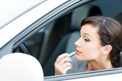 Woman applying makeup Stock Photos