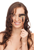 Woman applying makeup Stock Image