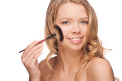 Woman applying makeup Royalty Free Stock Photos