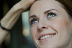 Woman applying makeup. Pretty woman makeup series. Closeup on face Stock Photography