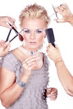 Woman applying makeup with brush and many hands. Beautiful woman applying makeup with brush and many hands royalty free stock photography