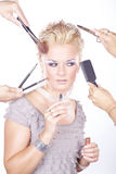 Woman applying makeup with brush and many hands. Beautiful woman applying makeup with brush and many hands stock photo