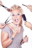 Woman applying makeup with brush and many hands. Beautiful woman applying makeup with brush and many hands stock photos