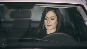 Woman applying makeup in the car stock footage