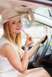 Woman applying makeup while driving her car Royalty Free Stock Photos