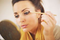 Woman Applying Makeup By Herself Royalty Free Stock Photography