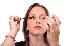 Woman applying mascara Royalty Free Stock Photo