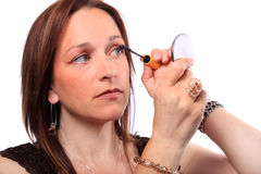 Woman applying mascara Royalty Free Stock Photos