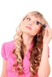 Woman applying mascara. Beautiful young blonde woman applying mascara on her eyelashes Stock Photos