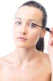 Woman is applying mascara Stock Photos