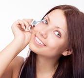 Woman applying mascara Stock Images