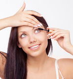 Woman applying mascara Stock Photography