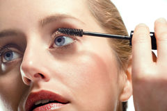Woman applying mascara royalty free stock photo