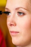Woman is applying mascara Royalty Free Stock Photography