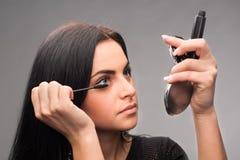 Woman applying mascara Royalty Free Stock Image