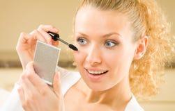 Woman applying mascara Stock Photo