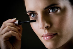 Woman applying mascara Stock Photo
