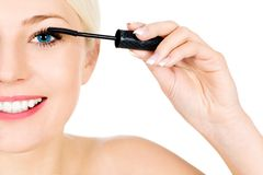 Woman applying mascara Royalty Free Stock Images
