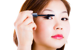Woman applying mascara Stock Photography