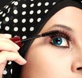 Woman applying mascara Stock Image