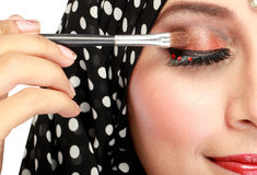Woman applying mascara Stock Image