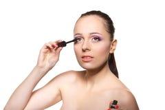 Woman applying mascara for eyelashes. Stock Images