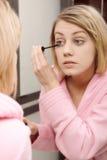 Woman applying mascara on eyelashes Royalty Free Stock Photos