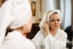 Woman applying mascara for eyelashes. Stock Photography