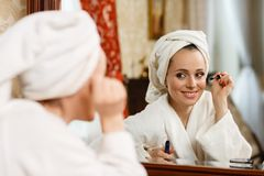 Woman applying mascara for eyelashes. Stock Photos