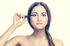 Woman applying mascara Royalty Free Stock Images