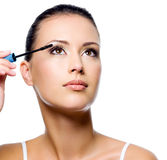 Woman Applying Mascara On Eyelashes Royalty Free Stock Image