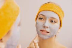Woman applying mask Royalty Free Stock Image