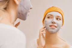 Woman applying mask Royalty Free Stock Images