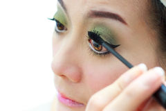 Woman Applying maskara. On her eyes Royalty Free Stock Images