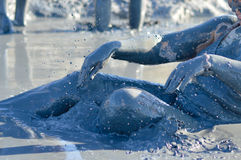 Woman applying mineral blue mud on body at Sivash lake Stock Images