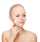 Woman applying moisturize cream. Royalty Free Stock Photography