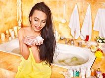 Woman applying moisturizer. Stock Photography