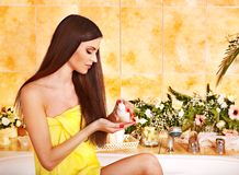 Woman applying moisturizer. Woman applying moisturizer at bathroom Stock Photos