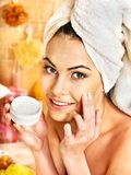 Woman applying moisturizer. Woman applying moisturizer at bathroom Royalty Free Stock Image