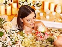 Woman applying moisturizer. Royalty Free Stock Photo