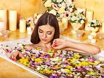 Woman applying moisturizer. Royalty Free Stock Photos