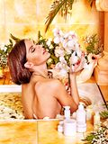 Woman applying moisturizer. Royalty Free Stock Images