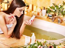 Woman applying moisturizer. Stock Photos