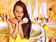 Woman applying moisturizer. Stock Images