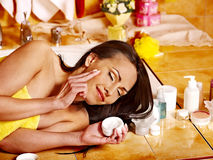 Woman applying moisturizer. Stock Photography