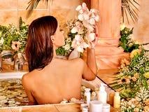 Woman applying moisturizer Royalty Free Stock Image