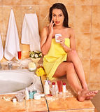 Woman applying moisturizer Royalty Free Stock Images